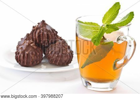 Fresh Mint Tea Concept On White Background. Mint Tea In A Transparent Cup And Some Mint Leaves On Th