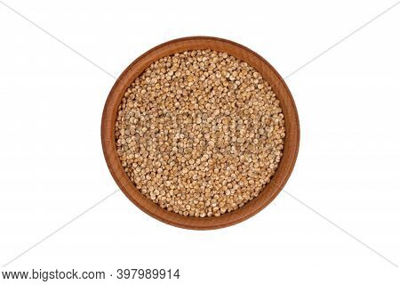Organic Quinoa Seeds In A Wooden Bowl