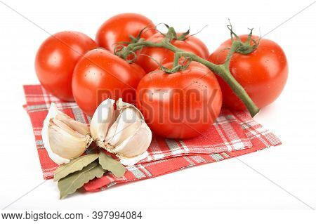 Red Tomato And Garlic On White Background. Homemade Red Tomato Harvest. Raw Yellow Tomatoes Are Read