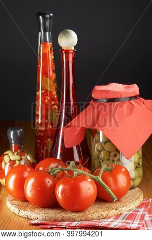 Red Tomatoes On Wooden Background. Homegrown Red Tomato Harvest. Raw Yellow Tomatoes Ready To Eat. C