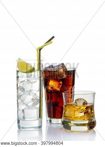 Variety Of Seasonal Cocktails On A White Background And Cold Drinks With Lime Juice. Variety Of Seas