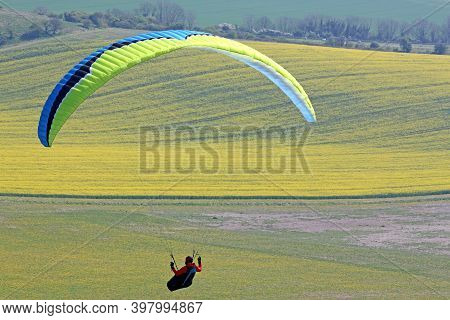 Paraglider Flying His Wing At Milk Hill, Wiltshire