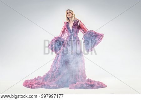 Fashionable Gorgeous Young Woman Posing In Exquisite Ruffled Ball Maxi Dress.  Elegant Look. Studio