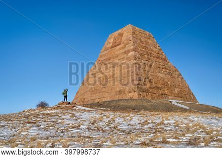Sherman, WY, USA - December 3, 2020: Ames Monument, a large pyramid at the highest point on the transcontinental railroad completed in 1860. It's dedicated to  Oliver and Oakes Ames brothers.