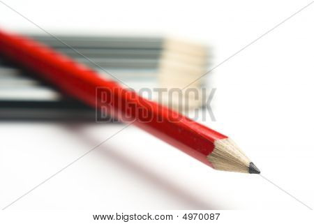 Red Pencil Crossing Grey Group Diagonally