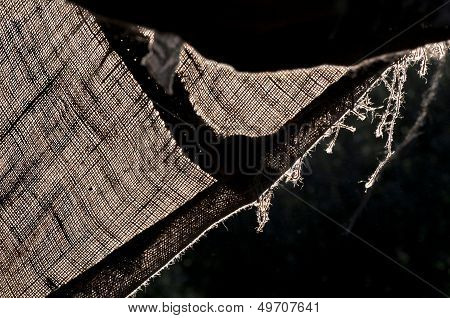 Backlight on a hanging hessian linen, sacking