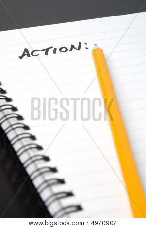 Writing Action In A Spiral-bound Notebook.