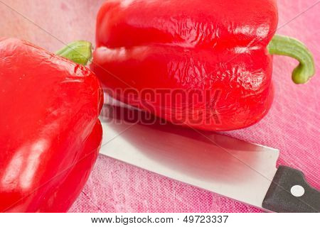 Two Red Peppers Waiting To Be Cutted