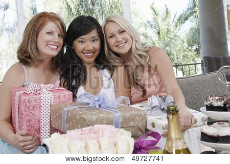 Portrait of multiethnic women with presents at wedding shower