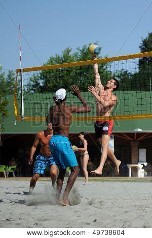 KAPOSVAR, HUNGARY - AUGUST 4: Leonel Munder (L) in action at a ROAK Viragfurdo Kupa beach volleyball competition, August 4, 2013 in Kaposvar, Hungary.