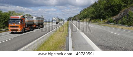 trucks and trafic on a busy highway, head on shot on trucks, panoramic view