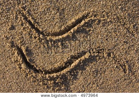 closeup of a wave sign in sand on a beach poster