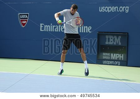 Professional tennis player Grigor Dimitrov practices for US Open 2013 at Louis Armstrong Stadium