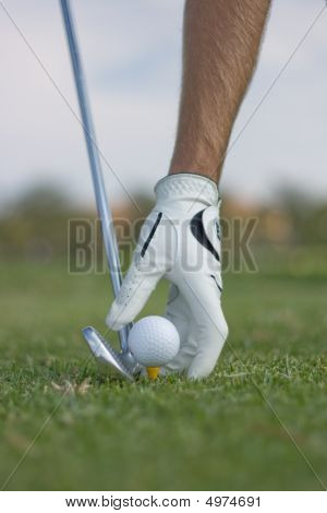 Placing Ball With Club Next To Ball