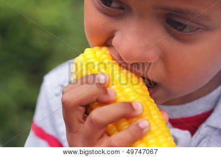 Hungry Indian Boy(kid) Eating Sweet Corn(healthy Food)