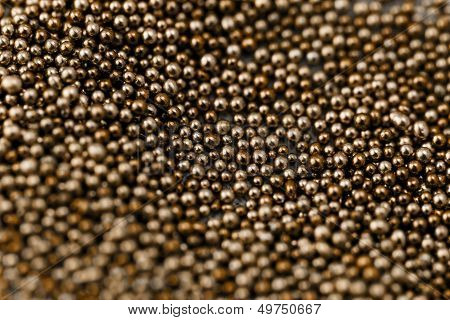 Pile brown balls of bead suitable for Background and texture poster