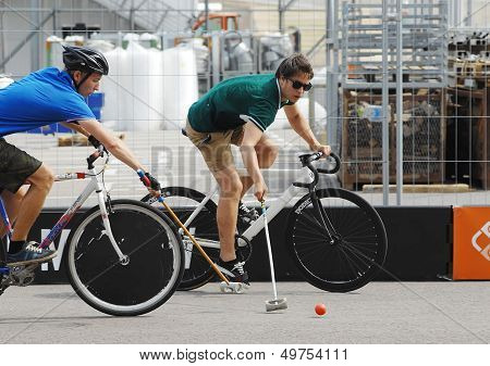 Two Bicycle Polo Players