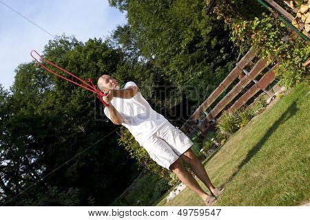 Man In Garden With Skipping Rope