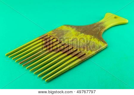 plastic comb isolated on the green background poster