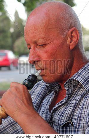 smoking a hookah waterpipe