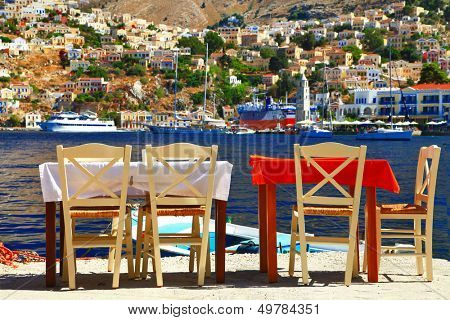traditional Greece - tavernas near sea. Symi island, Dodecanese