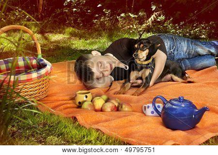 Boy Sleeping On Blanket With His Dog