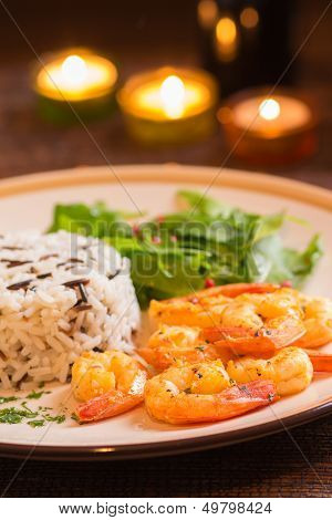 Grilled Shrimps With Rice In Romantic Atmosphere