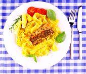 Grilled salmon fillet with taglateli lemon basil top view poster