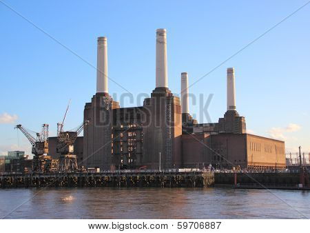 Old coal power plant with chimenys at waterfront poster