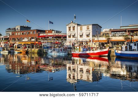 WARNEMUNDE, GERMANY - SEPTEMBER 13, 2013: Warnemunde cityscape on Alte Strom old channel. Founded in 1200, the once sleepy fishing village has grown into a prominent seaside resort town.