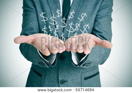 a businessman showing a pile of drawn dollar sign in his hands