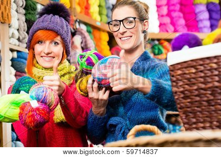 Young women buying colorful wool and yarn for their hobby in knitting fashion shop