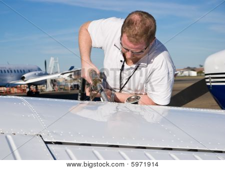 Man filling areoplane