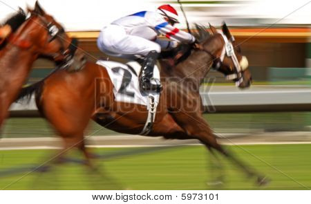 Slow shutter speed rendering of racing horse and jockey poster