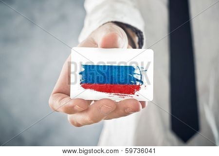 Russian Businessman Holding Business Card With Russia Flag