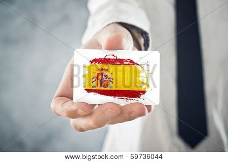 Spanish Businessman Holding Business Card With Spain Flag
