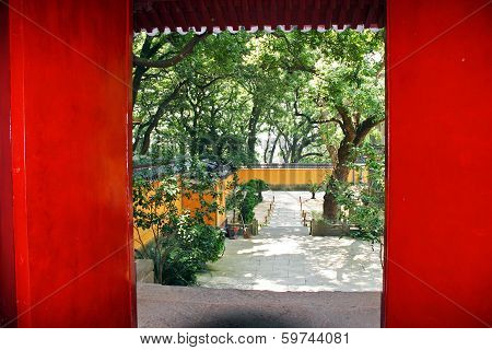 Red Door Revealing A Beautiful Temple Courtyard In Putuo Shan, China