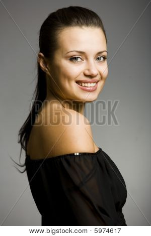 Portrait Of Smiling Young Woman With Nacked Shoulder