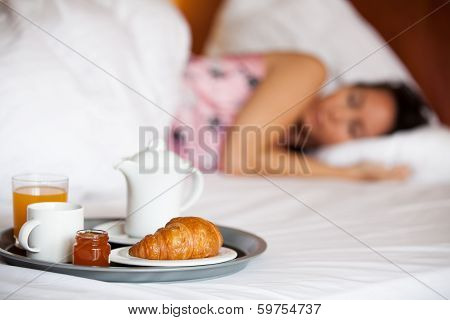 Hotel breakfast and a sleeping woman