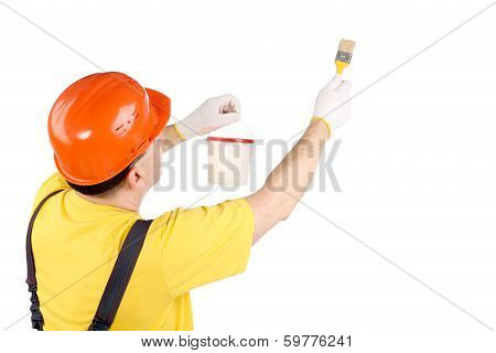 Worker in hardhat with paint brush.