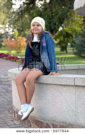 girl smiling on stone