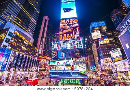 NEW YORK, NEW YORK - APRIL 9, 2013: Times Square lights at night in Midtown Manhattan. The site is regarded as the world's most visited tourist attraction with nearly 40 million visitors annually.