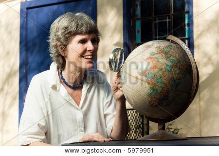 Senior lady planning her retirement travel