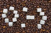 Funny composition of sugar in the form of a emoticon on the background of coffee beans poster