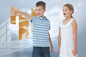 Young boy showing something to his sister against room with holographic cloud poster