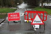 Road closed and flood sign due to heavy rain and floods poster