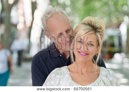 Loving Mature Couple In An Intimate Embrace