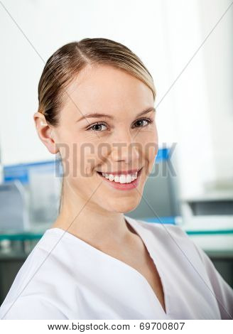 Portrait of beautiful researcher smiling in hospital poster