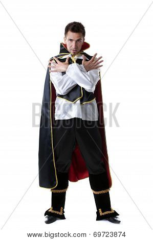 Pretentious man posing in costume of illusionist