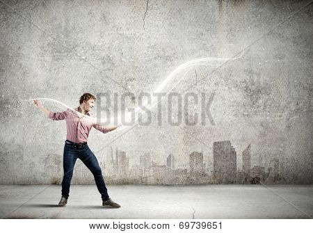 Young man in casual throwing light splashes poster